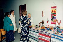 Alvira Friesen, missionary in Mexico, at Mexico display table