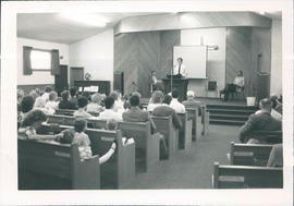Lester Kroeker, youth pastor, leading Sunday morning service - 2 pictures