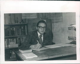 Glen Koop, one of the instructors at SBC, at his desk