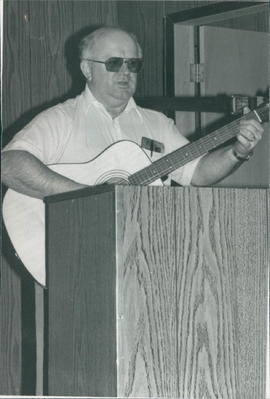 Frank Braun, missionary, leading singing at the Reserve service