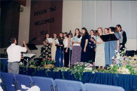 Abe Bueckert, Taber, Alta., leads choir (likely a practice)