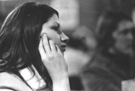 A young woman listens attentively at the 1970