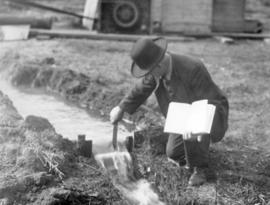 Abraham M. Bowman testing water flow at a new