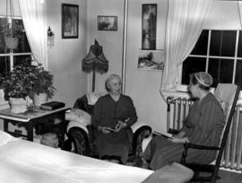 Two women sitting in the room of Mrs. J. Albright at Braeside Home in Cambridge, Ontario