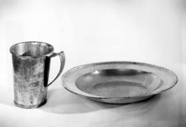 Pewter plate and tin cup used for communion by