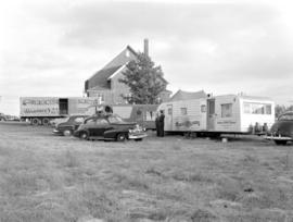 Cars and motor homes parked beside Steinmann Mennonite Church