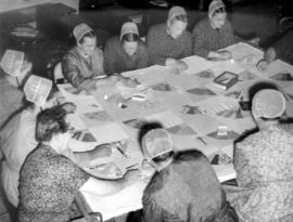 Old Order Mennonite women quilting in a local