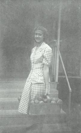 Mary Burkhart with basket of potatoes