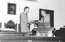 William Zehr presents the new film to Walter H. Dyck