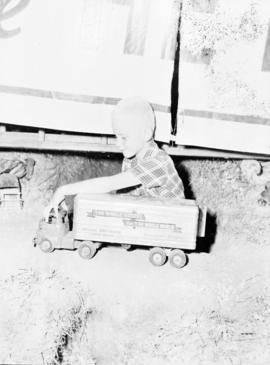 Conrad Brunk playing with a minature truck