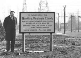 Herman W. Enns, pastor of the Hamilton church stands on the site of the future church building