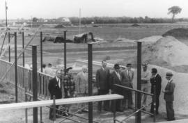 A group of men are on the construction site of Mennonite Biblical Seminary (Elkhart)