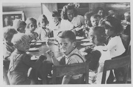 Children in Germany around a table eating