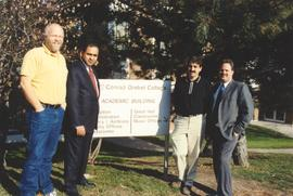 Four men with the Grebel sign