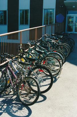 Bicycles parked by the academic  building at