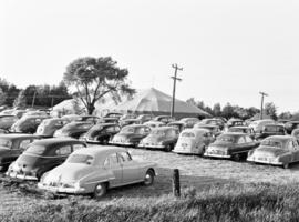 Cars parked near tent for the Hammer revival