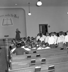 Massed children's choir practicing at St. Jacobs Mennonite Church