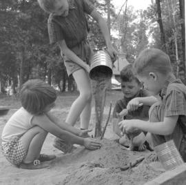 Children playing in the sand at Chelsey Lake