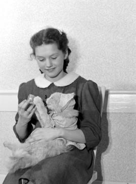 Joyce Siebert, daughter of Clayton Siebert, holding her cat