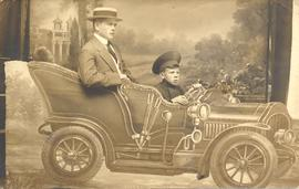 Abram Martens and younger brother sitting in car