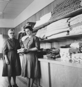 Gladys Cressman Grove and Leona Schmitt with supplies in the Cutting Room