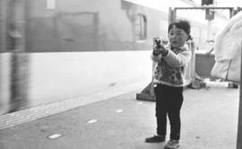 A young boy, perhaps 3 years old, is pointing a