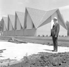 J.J. Reimer in front of new Artifacts Building of the museum