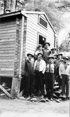 Alternative service workers in front of a cabin