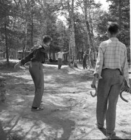 A game of horseshoes Chesley Lake Camp in