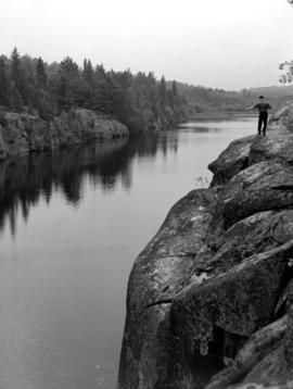 A man standing beside the French River in Ontario