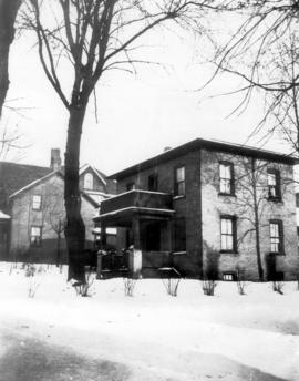 L-R: the Stuebing house and the J. Troxel house