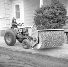 Edwin Peters'  son rides a small Case 195 tractor