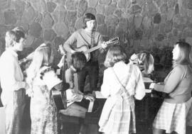 Students playing music in the chapel