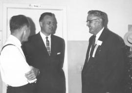 . J. M. Klassen is welcomed by David and Paul Schroeder