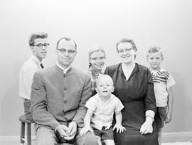 Roy Koch and family posing for visas