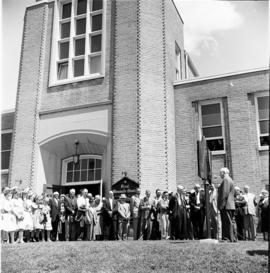 Crowd standing in front of First Mennonite Church