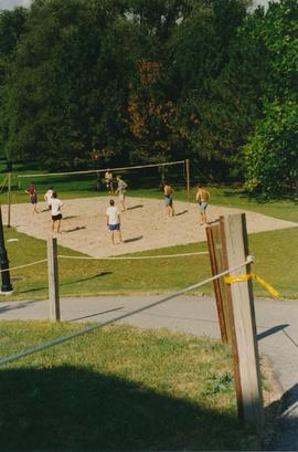 Students playing volleyball on the court at