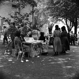 Old Order Mennonite women selling educational materials from Pathway Publishers at the Relief Sale in New Hamburg, Ontario