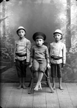 Henry and Otto Rempel with friend (middle).