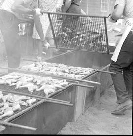 Barbequing chicken legs at the Relief Sale in New Hamburg, Ontario