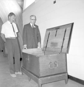 Norman Reimer (left) & J.J. Reimer stand beside a chest built in Russia