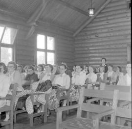 Participants sit in the chapel