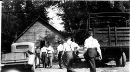 Alternative Service workers enter the camp dining hall