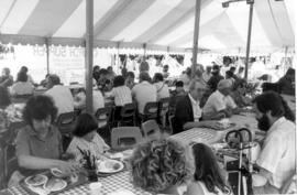 Guests enjoying Church Supper in Food Tent at