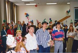 Students at a birthday party for Conrad Grebel College