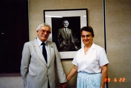 Ralph and Eileen Lebold in front of his portrait