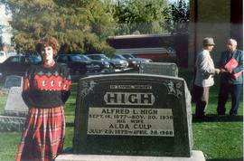 Elizabeth High standing next to tomb of Alfred L.