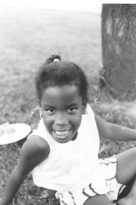An Afro-American girl looks directly at the camera