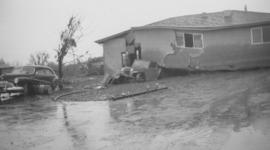 Badly damaged home and flooded area