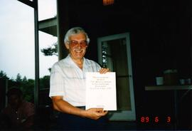 "Ralph Lebold with his ""honorary alumnus"" certificate"